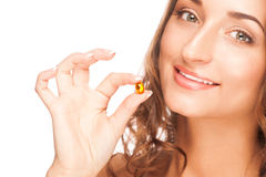 Woman with pill Stock Image