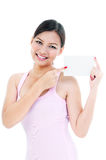 Healthy Young Woman Pointing At Card Royalty Free Stock Images