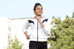 Healthy young woman running outdoors in the city Royalty Free Stock Photos