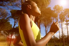 Healthy young woman running outdoors royalty free stock image