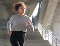 Healthy young woman running outdoors Stock Photos
