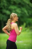 Healthy young woman running in the park Royalty Free Stock Image
