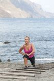 Healthy young woman running on thr beach Royalty Free Stock Image