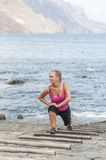 Healthy young woman running on thr beach Stock Images