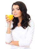 Healthy young woman sipping fresh orange juice Stock Images
