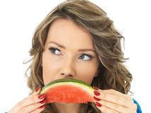 Healthy Young Woman With a Slice of Water Melon looking Unhappy. A DSLR royalty free image, young attractive thoughtful unhappy woman, with dark blonde curly royalty free stock photos