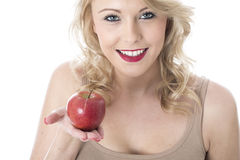 Healthy Young Woman Smiling Holding a Red Apple Royalty Free Stock Image