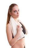 Healthy young woman after sport with towel on shoulder Royalty Free Stock Photos