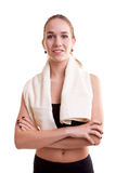 Healthy young woman after sport with towel on shoulder Stock Photography
