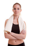 Healthy young woman after sport with towel on shoulder Royalty Free Stock Images