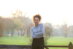 Healthy young woman standing in nature smiling Stock Image