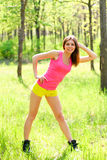 Healthy young woman stretching before Fitness and Exercise Royalty Free Stock Image