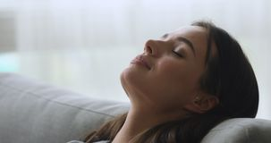 Healthy young woman taking deep breath of fresh air