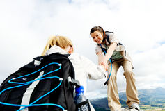 Healthy young women climbing outdoors royalty free stock image