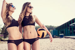 Healthy young women laughing with beachball Stock Photography