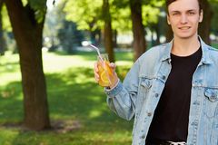 Healthy youth lifestyle. Happy guy with detox Royalty Free Stock Image
