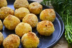 Close up of Home made rice italian style Croquette.Arancini with runa fish. Healty  baked Rice balls or croquette with parmesan cheese, tuna fish royalty free stock images