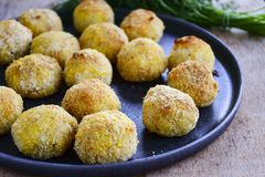 Close up of Home made rice italian style Croquette.Arancini with runa fish. Healty  baked Rice balls or croquette with parmesan cheese, tuna fish royalty free stock photos