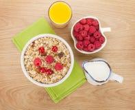 Healty breakfast with muesli, berries, milk and orange juice Stock Photos
