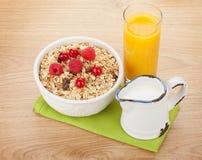Healty breakfast with muesli, berries, milk and orange juice Royalty Free Stock Images