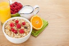 Healty breakfast with muesli, berries, milk and orange juice Royalty Free Stock Image