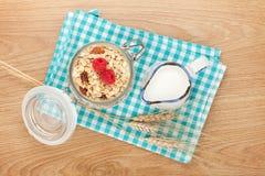 Healty breakfast with muesli, berries and milk Stock Photo