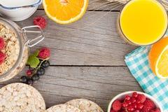 Healty breakfast with muesli, berries and orange juice Stock Photo