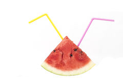 Healty food concept. Watermelon piece with colorful straws isolated on white Royalty Free Stock Photography