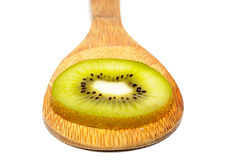 Healty Kiwi Fruit Slices on wooden ladle isolated Stock Photo