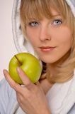 Healty woman with apple. In her hand Royalty Free Stock Photo