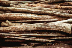 Heap of aged brown wooden logs Royalty Free Stock Images