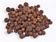 Heap of allspice on a white. Background stock photo
