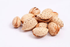 Heap of almond. Handful of almonds isolated on white background Royalty Free Stock Photo