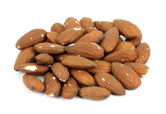 Heap of almond nuts isolated on white background Stock Image