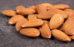 Heap of almonds on concrete structure Stock Photo
