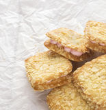 Heap of almonds cookies on crumpled paper Stock Photography