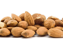 Heap of almonds isolated Stock Image