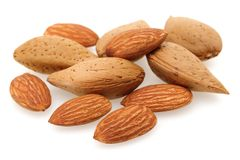 Heap of almonds isolated on white. Background royalty free stock photos