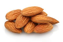 Heap of almonds isolated on white. Background stock images