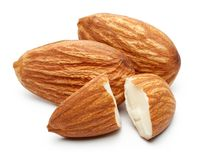 Heap of almonds isolated on white. Background royalty free stock image