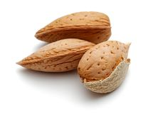 Heap of almonds isolated on white. Background stock photo