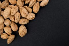 Almonds  in shell. Heap of almonds in shell isolated on black. Raw food ingredients Stock Images