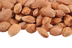 Heap of almonds on a white Stock Photography