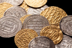 Heap of ancient islamic golden and silver coins Stock Photos