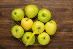 Heap of apples in the net bag from the store on Royalty Free Stock Images