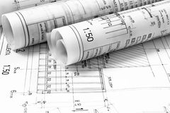 Heap of architect design and project drawings. On table background royalty free stock photography