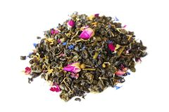 Heap of aromatic dry green tea with cornflower and small dry buds of roses royalty free stock photography