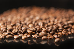 Heap of Aromatic Roasted Coffee Beans Placed over Black Backgrou Stock Image