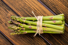 Heap of Asparagus Sprouts  on Rustic Royalty Free Stock Photography