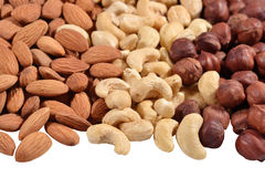 Heap of assorted nuts on a white Royalty Free Stock Photography
